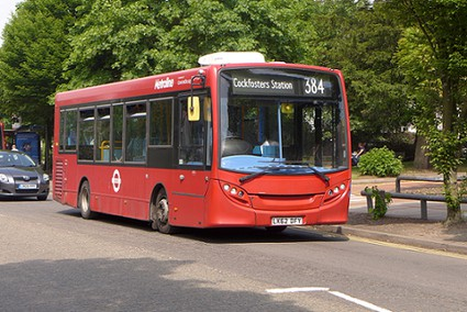 red 384 bus to Cockfosters Station with trees in the background