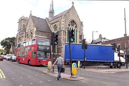 bus and turning lorry in front of church