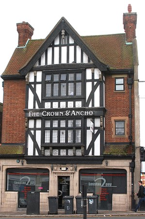 half-timbered and red brick ex-pub 'The Crown and Anchor' with accountants office on ground floor