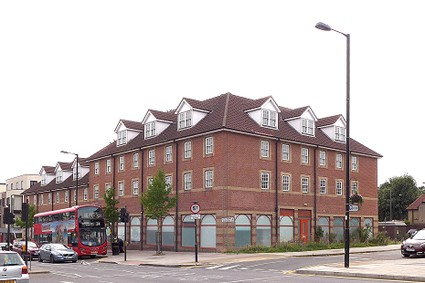 large modern four storey red brick building with dormer windows