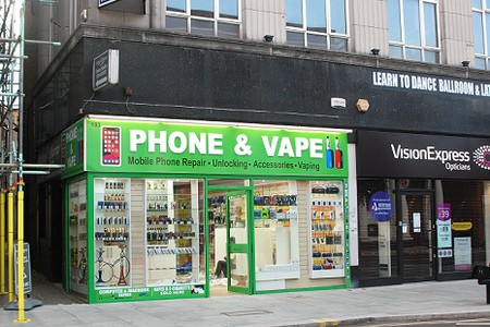 Phone and Vape shop with bright green frontage and large lettering