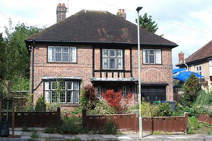 arts-and-crafts red brick double-fronted house
