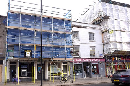 two shops, more scaffolding
