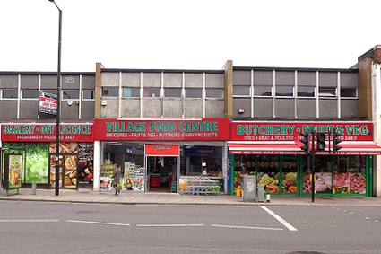 shop with fruit and vegetables outside