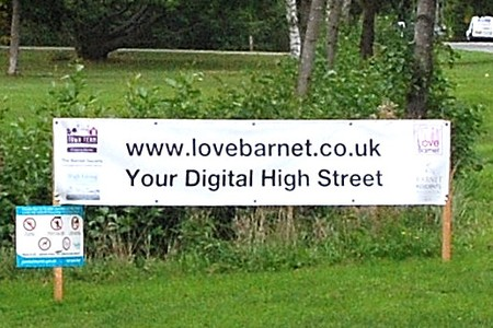 Sign with web address 'www.lovebarnet.co.uk' and slogan 'Your Digital High Street'